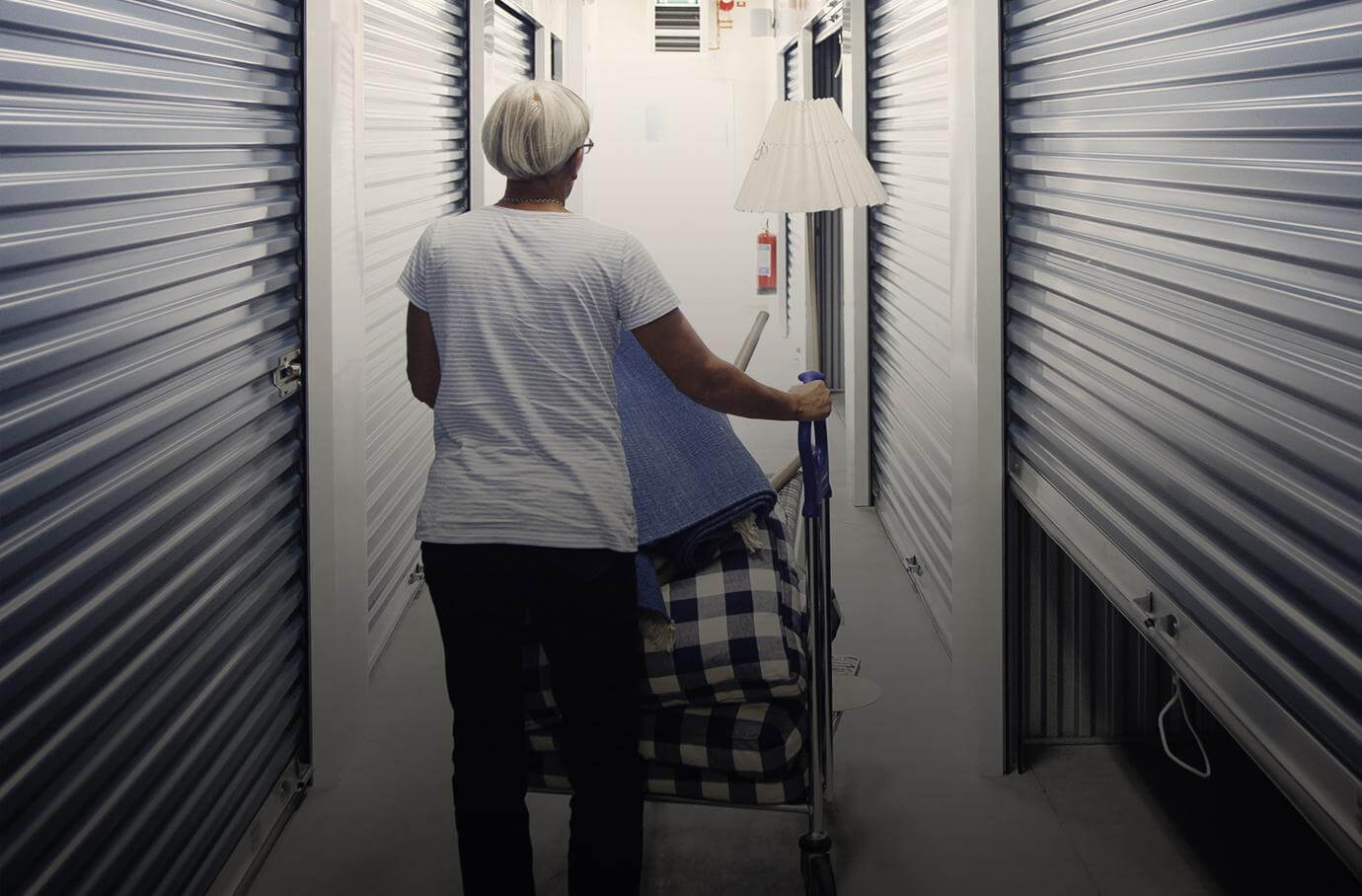 Woman walking in a self storage isle.