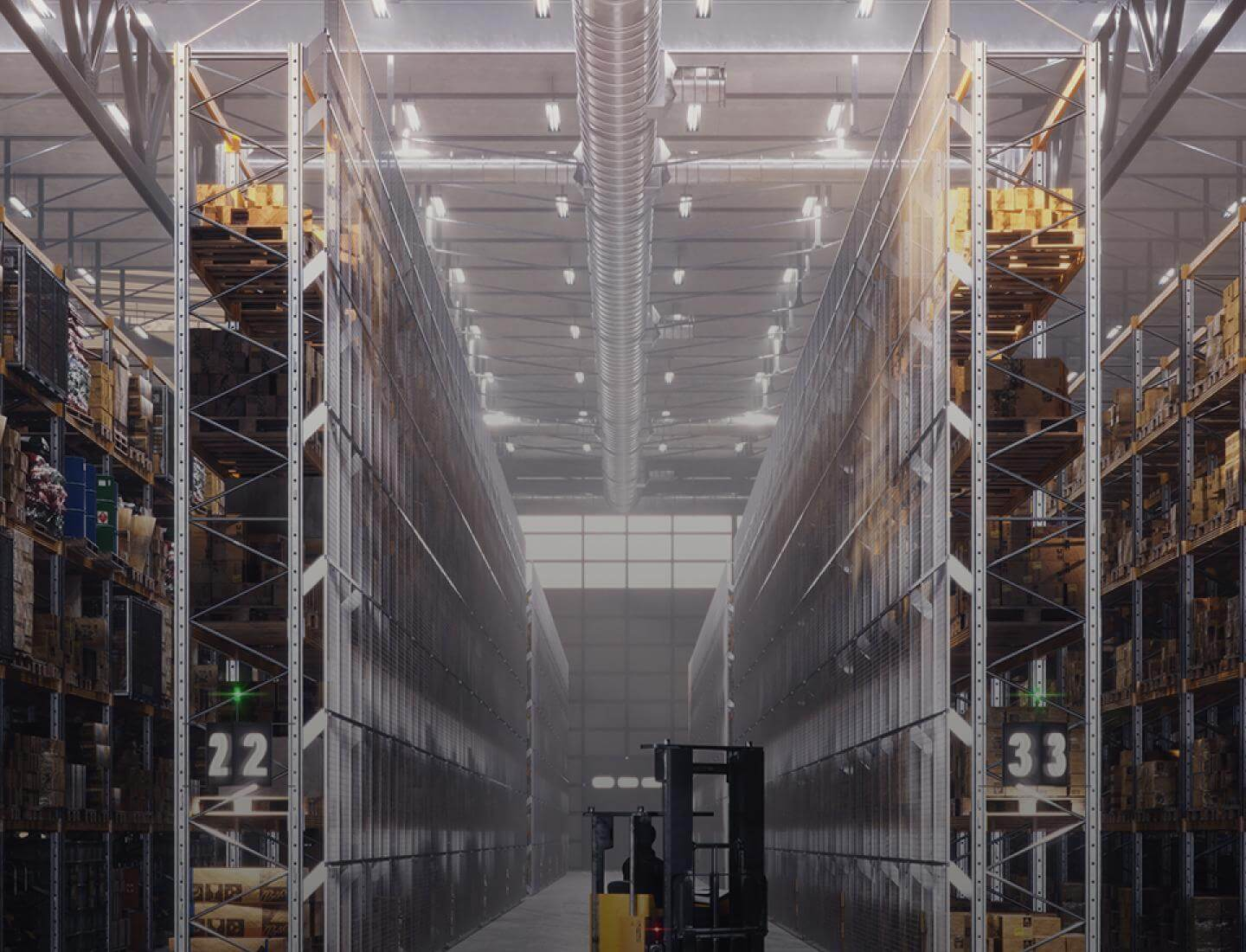 Troax anti-collapse system in a warehouse with pallet racks.
